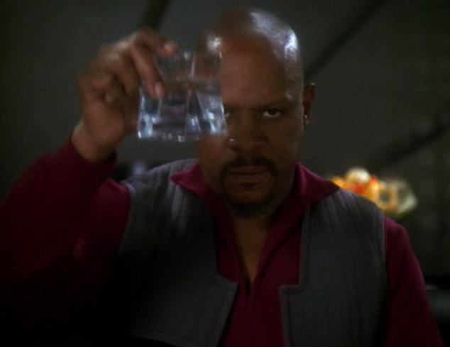 Captain Sisko, resigned, offers a toast to the 'good guys'